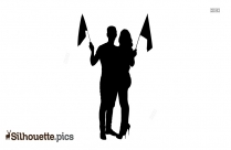 Couple Holding Flags Silhouette