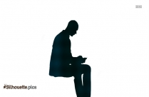Man Sitting And Using Phone Silhouette
